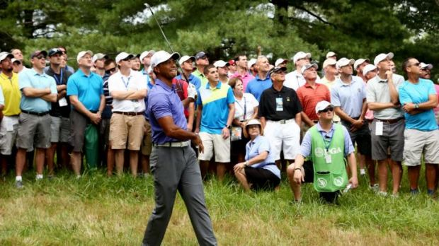 Rough shot: Tiger Woods was nine strokes off the lead after the first round of the US PGA Championship.