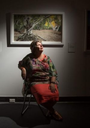 Winner of the works on paper category: Nici Cumpston for her work <i>Scar Tree, Barkindji Country</i>.
