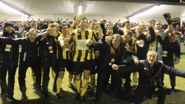 Glory days: South Springvale players, fans and officials celebrate as the team marches on in the FFA Cup.