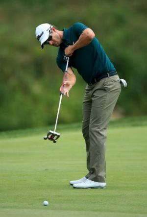 "Broom service: Adam Scott had mixed success with ""that"" putter during the first round of the PGA Championship."