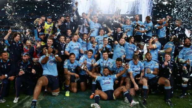 The Waratahs celebrate their triumph against the Crusaders.
