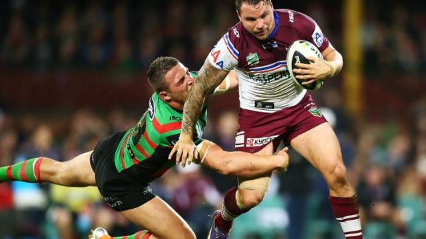 Going nowhere: Sam Burgess gets to grips with Anthony Watmough.