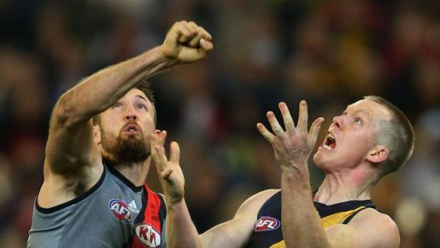 Cale Hooker of Essendon and Jack Riewoldt of Richmond have eyes only for the ball.