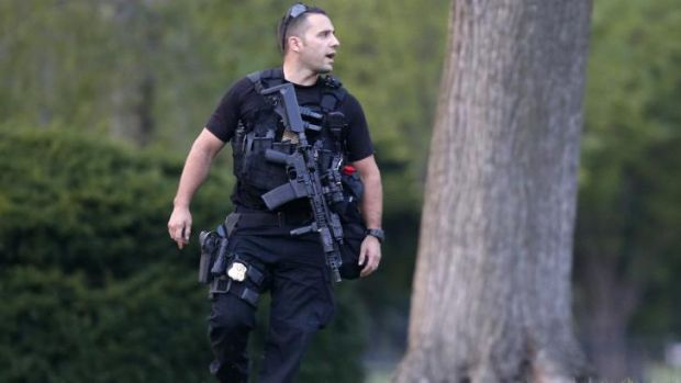 The Pacifier: A member of the US Secret Service Emergency Response team stands watch at the White House.