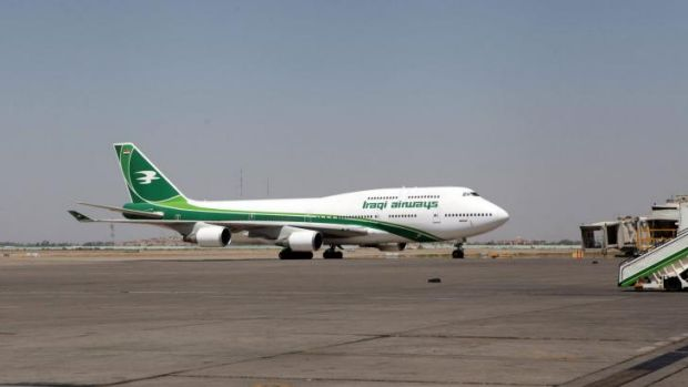 An Iraqi Airways Boeing 747 sits at Baghdad International Airport on Tuesday. The FAA has banned US airlines from flying ...