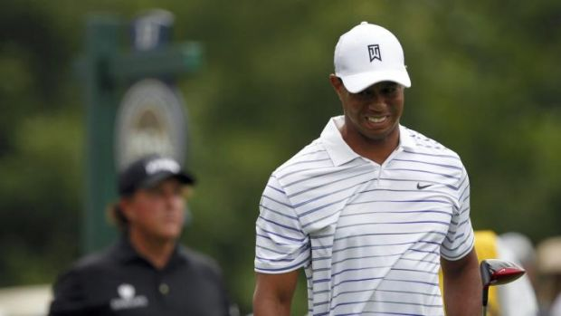 Tiger Woods grimaces after his tee shot on the 17th hole.