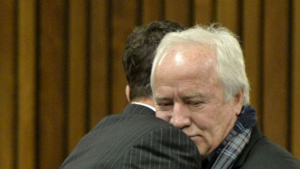 Oscar Pistorius is hugged by his father on the last day of the trial.