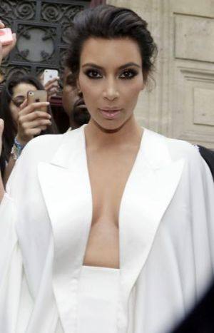 Product of the age: Kardashian in the spotlight in Paris.