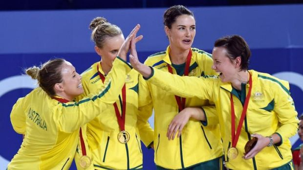 Australian players celebrate after winning the netball title at the Glasgow Commonwealth Games.
