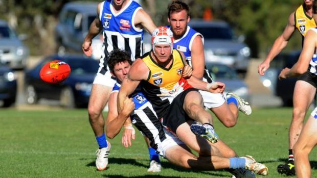 Against all odds: Phil Butsch in action for the Horsham Saints.