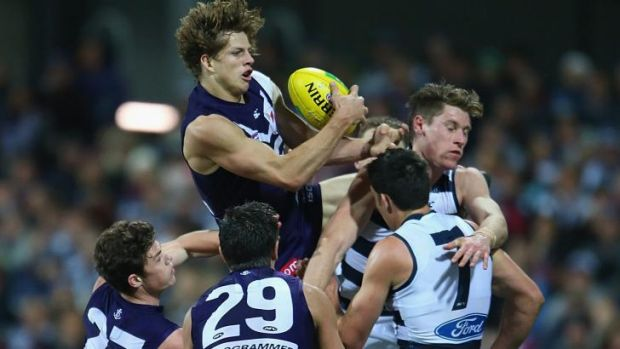 Flying star: Docker Nat Fyfe grabs a high mark during Geelong's two-point victory at Simonds Stadium on Saturday night.
