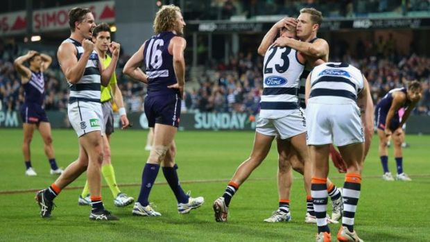 David Mundy (16) walks away after missing a kick at goal after the siren. The miss gave Geelong victory by two points.