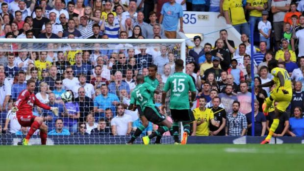 Warming up: Adebayor fires home the opener for Spurs.