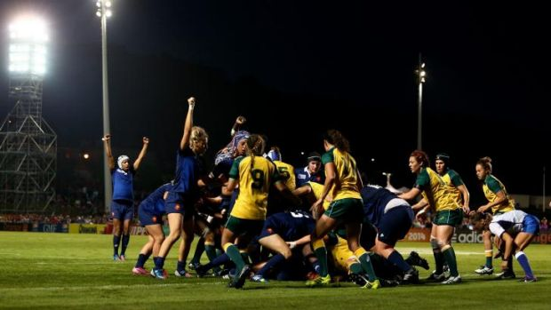 Bleus murder: France celebrate after Gaelle Mignot scores a try against the Wallaroos.