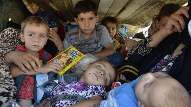 Displaced Iraqis, who fled from the violence in the province of Nineveh, arrive at Sulaimaniya province in Kurdish Iraq.