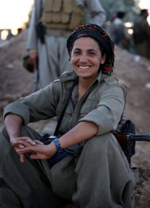 A Kurdistan Workers' Party member at the frontline with ISIL in Makhmour, near Erbil.