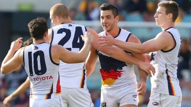The Crows celebrate a goal.