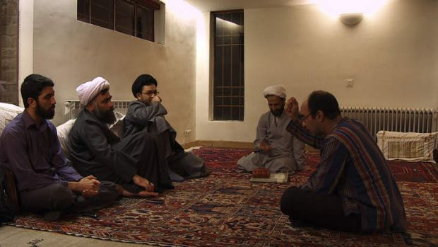 Mehran Tamadon, right, tries to convince his guests of the merits of a secular society in his film <i>Iranian</i>, ...