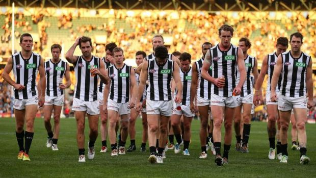 Collingwood players leave the ground after their 60-point loss to West Coast on Sunday.