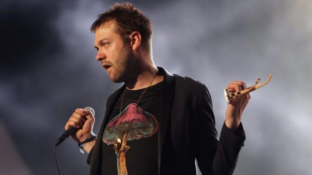 Kasabian's Tom Meighan in concert.