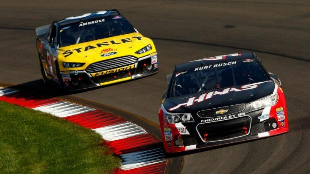 Kurt Busch leads Marcos Ambrose during the race in New York.