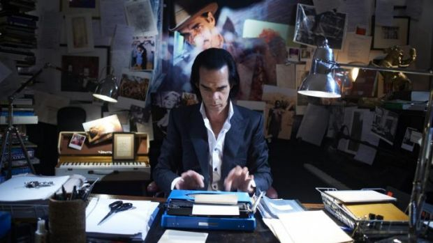 Cave cave: Nick Cave at work in his dimly lit and cluttered study in which he writes his songs.