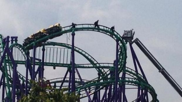 Firefighters make their way to stranded rollercoaster riders at the Six Flags America resort in Largo, Maryland.