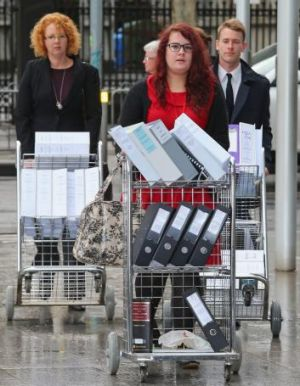 Documents are wheeled into the court on Monday.