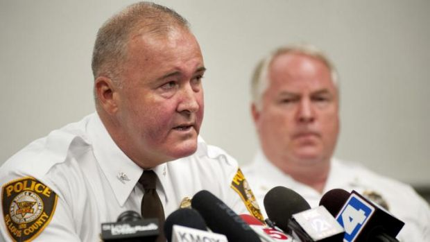 St Louis County Police Chief Jon Belmar, left, delivers remarks as Ferguson Police Chief Thomas Jackson listens during a ...