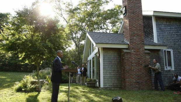 Backing a new Iraqi government: Barack Obama speaking from his vacation compound.