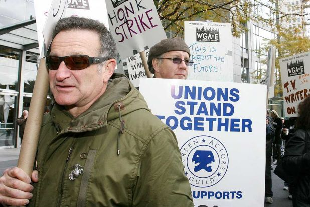 Robin Williams marches in a picket line during the fourth day of a strike by television and film writers in New York in ...