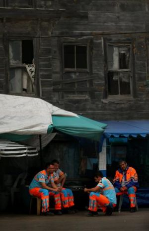 Council workers take a break in the sleepy fishing village of Garipce, Istanbul.