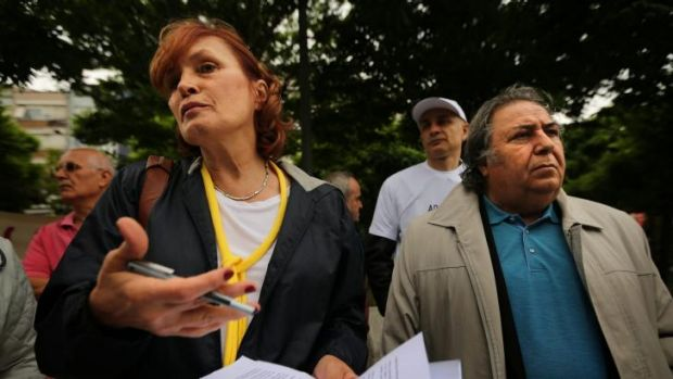 Irem Kutluk (left), the wife of detained Turkish admiral Ali Deniz Kutluk, demands justice for her husband and other ...