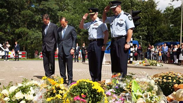 Remember them: Tony Abbott with special envoy Angus Houston, defence chief Mark Binskin and AFP commissioner Tony Negus ...