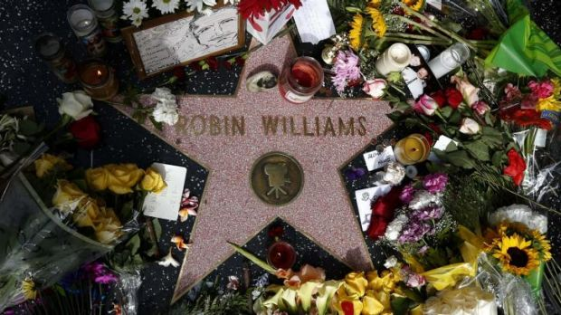 A floral tribute at the Hollywood star of Robin Williams.