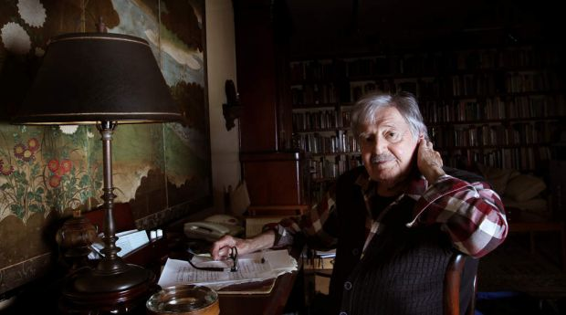 Peter Sculthorpe in April 2013 in his music room, the back wall lined with books and a beautiful screen on one wall.