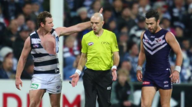 Ross Lyon doesn't want umpires guessing at free kicks for players like Steve Johnson (left).