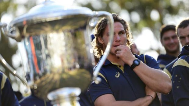 What's that?: Wallabies captain Michael Hooper eyes the Bledisloe Cup trophy his country hasn't lifted since 2002.
