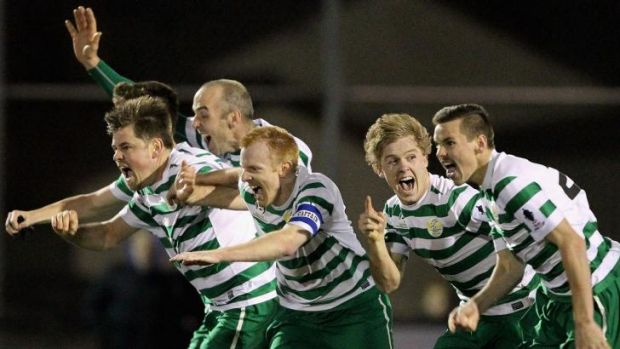 Tuggeranong players celebrate their penalty shootout win over South Hobart in the FFA Cup.