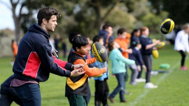 Richmond captain Trent Cotchin conducts a football clinic with children participating in the Australia Post ...