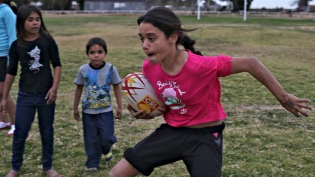 Boots and all: League and soccer are the sports of choice in Wilcannia.