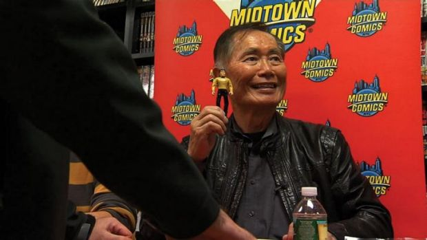 Space hero: George Takei holds a model of  himself in the new documentary, <em>To Be Takei</em>.