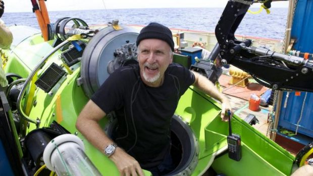 Prepare to dive: James Cameron emerges from the submersible after reaching the bottom of the Mariana Trench.