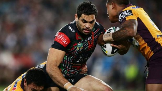 Unstoppable: Greg Inglis takes on the Broncos defence.