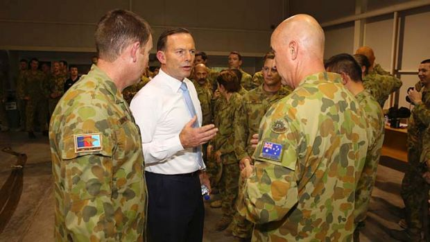 Tony Abbott meets Australian troops at Al Minhad Air Base in the United Arab Emirates on Thursday.