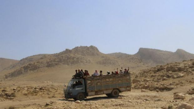 Displaced Yazidis are taken away from the violence around Mount Sinjar.