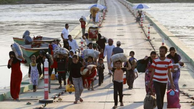 Displaced people from the minority Yazidi sect, fleeing violence near the Iraq-Syria border.