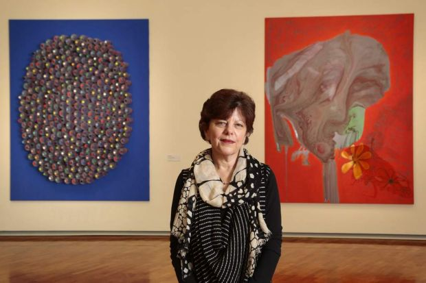 National Gallery of Australia senior curator Deborah Hart with two of the works donated by Australian artist Dale Frank.