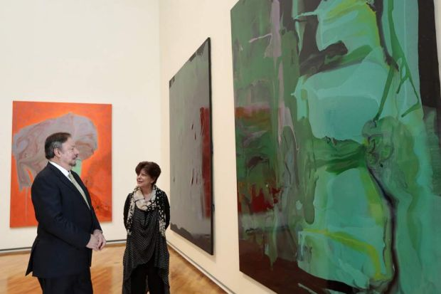 National Gallery of Australia director Ron Radford and senior curator Deborah Hart looking at some of the Dale Frank works.