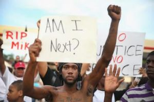 Demetrus Washington joins demonstrators protesting the shooting death of Michael Brown in Ferguson, Missouri.